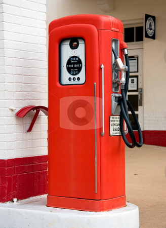 Old red gas pump stock photo, Close up of an old vintage gas petrol pump in place when gas was very inexpensive by Steven Heap
