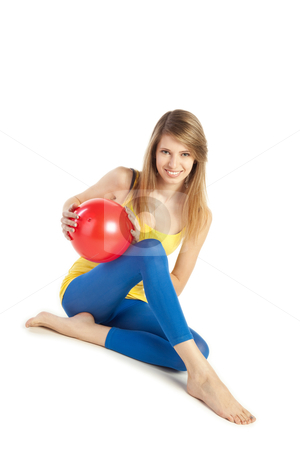 Sportive girl with red ball stock photo, Pretty smiling young blond woman in sportive cloths holding red ball by Mikhail Lavrenov