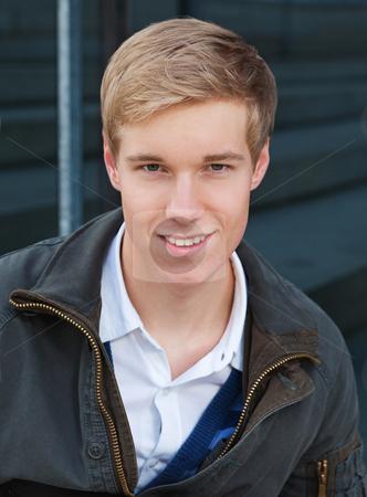 Handsome young blond man stock photo, Portrait of smiling blond handsome young man outdoors by Mikhail Lavrenov