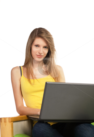 Young blond woman with computer stock photo, Young blond pretty woman sitting on sofa with laptop computer; isolated on white by Mikhail Lavrenov