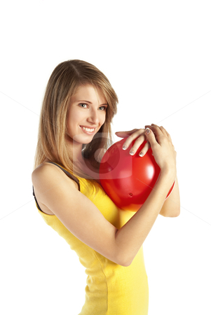 Smiling blond girl with red ball stock photo, Pretty smiling young blond woman in sportive cloths holding red ball by Mikhail Lavrenov