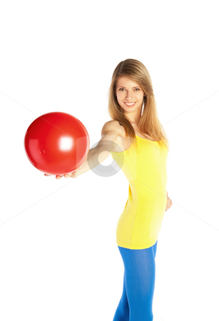 Pretty blond girl with red ball stock photo, Young happy blond woman standing on tiptoe and holding red ball by Mikhail Lavrenov