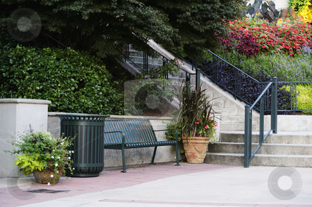 A place to rest stock photo, A bench by stairs in an outdoor shopping area by Gerry Daniel