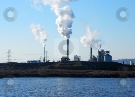 Climate Change stock photo, A factory emits greenhouse gas by Tim Elliott