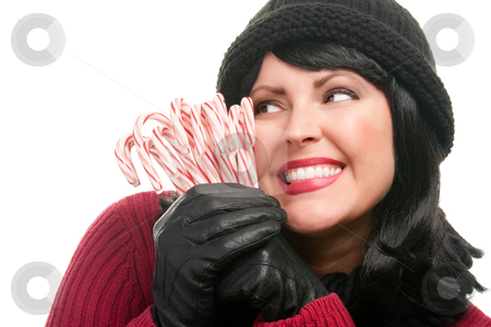 Pretty Woman Holding Candy Canes stock photo, Pretty Woman Holding Candy Canes Isolated on a White Background. by Andy Dean