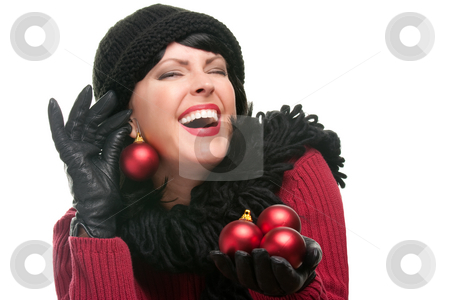 Attractive Woman Holding Christmas Ornaments stock photo, Attractive Woman Holding Christmas Ornaments Isolated on a White Background. by Andy Dean