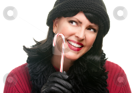 Pretty Woman Holding Candy Cane stock photo, Pretty Woman Holding Candy Cane Isolated on a White Background. by Andy Dean