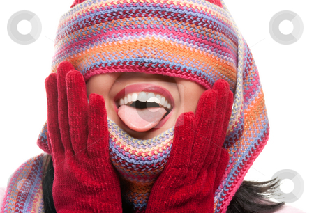 Attractive Woman With Colorful Scarf Over Eyes Sticking Out Tong stock photo, Attractive Woman With Colorful Scarf Over Eyes Sticking Out Tongue Isolated on a White Background. by Andy Dean