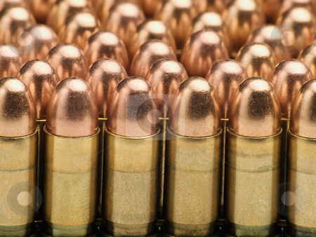 Rows of bullets stock photo, Rows of bullets, useful for backgrounds and themes involving crime,war,military,terrorism by Vladimir Koletic