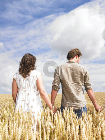 Couple hugging in wheat field stock photo, Couple hugging in the middle of a wheat field by Mog Ddl