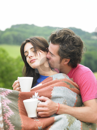 Couple having coffee stock photo, Young couple having coffee outside in the morning by Mog Ddl