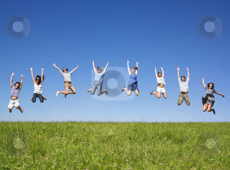 Group jumping  stock photo, Group of friends Jumping in meadow under blue sky by Mog Ddl