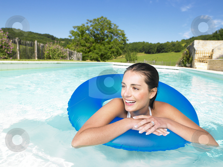 Woman in pool stock photo, Woman in swimming pool inside a blue ring by Mog Ddl