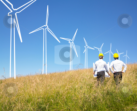 Engineers building windmills stock photo, Engineers in field with plans building windmills by Mog Ddl