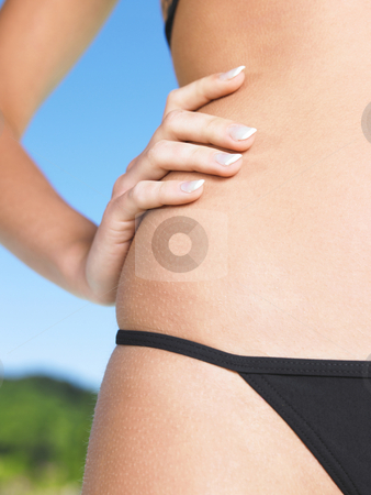 Woman in bikini stock photo, Body parts of woman in black bikini by Mog Ddl