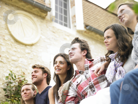 Group of Friends Outdoors, Looking Into the Distance stock photo, Group of young people together outdoors, looking away into the distance. Horizontal. by Mog Ddl