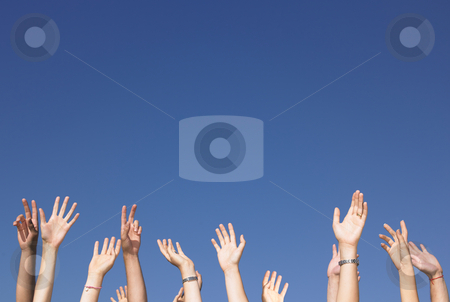 Arms Raised Against Blue Sky stock photo, Cropped view of group of people with arms raised against a blue sky. Horizontally framed shot. by Mog Ddl