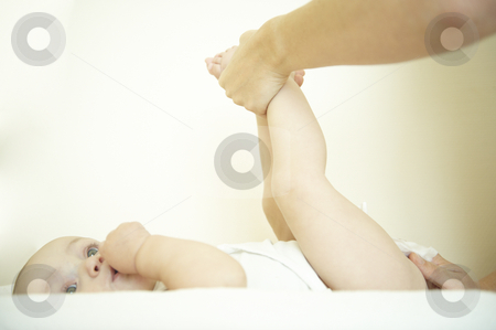 Baby Getting Diaper Changed stock photo, Adult changing baby's diaper. Horizontally framed shot. by Mog Ddl