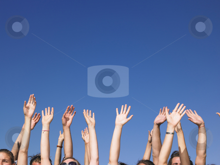 People With Arms Raised stock photo, People with hands in the air, with only the tops of their faces visible. Horizontal. by Mog Ddl