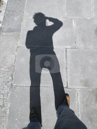 Shadow of Photographer on Walkway stock photo, Photographer takes a picture of the shadow he/she is casting. Vertically framed shot. by Mog Ddl
