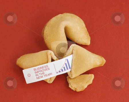 New Year Business Fortune stock photo, Two fortune cookies on a red background. One is opened, showing a fortune saying,