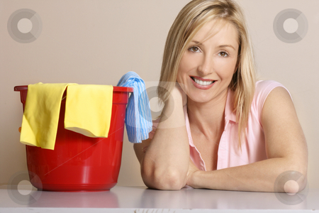 Clean Up Houscleaning stock photo, This image depicts a woman with a cleaning bucket, gloves and cleaning cloth. by Leah-Anne Thompson