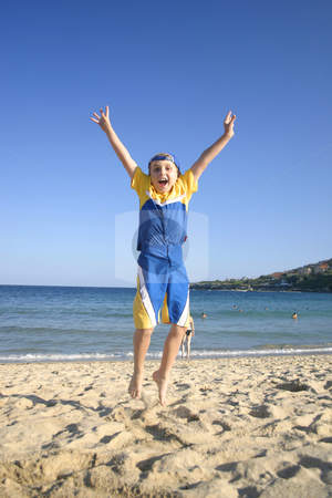 Woo Yay!   Boy Jumping for Joy stock photo, Woo Yah!  Child leaps into the air on the beach -- very late autumn afternoon. by Leah-Anne Thompson