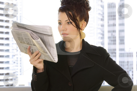Financial Review stock photo, Reading the financial newspaper