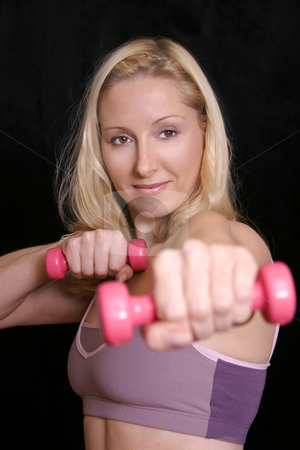 Weight Training - fitness exercise aerobics stock photo, Female during a weights workout against a dark background by Leah-Anne Thompson