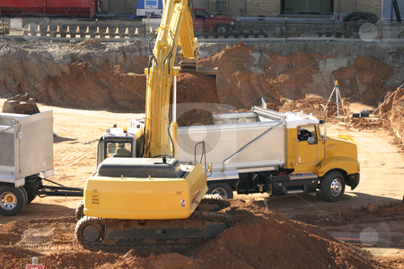 Construction Industry in progress stock photo, Filling a dump truck with dirt on a construction site. by Leah-Anne Thompson