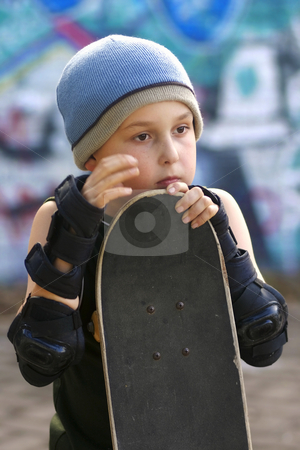Child with skateboard stock photo, A boy with his skateboard waits his turn by Leah-Anne Thompson