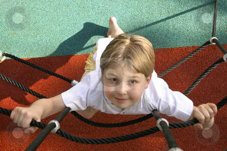 Playtime - boy at playground stock photo, Young boy on climbing ropes - playground by Leah-Anne Thompson