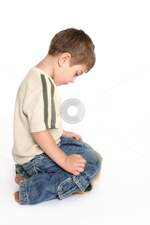 Ashamed stock photo, A toddler bows his head in shame. by Leah-Anne Thompson