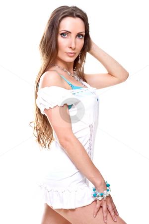 Beautiful woman in a white dress stock photo, Beautiful woman in a white dress on a white background isolated by Artem Zamula