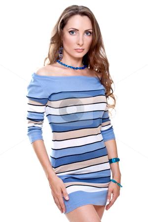 Beautiful woman in a striped dress stock photo, Beautiful woman in a striped dress on a white background isolated by Artem Zamula