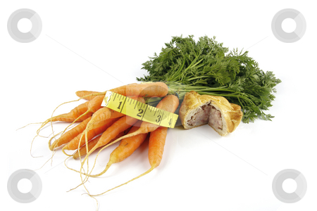 Carrots and Pork Pie with Tape Measure stock photo, Contradiction between healthy food and junk food using bunch of carrots and pork pie with a tape measure on a reflective white background by Keith Wilson