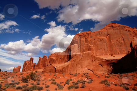 Arches National Park ,Park Ave stock photo, View of the red rock formations in  Arches National Park with blue sky by Mark Smith