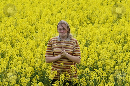 Men in yellow flowers stock photo, Happy young man in the yellow flower meadow. by Roberts Ratuts