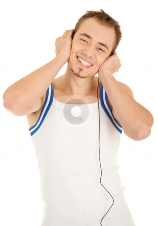 Smiling handsome man is listening music stock photo, Smiling handsome young man in casual style with headphones is listening music, isolated on white background by Iryna Rasko