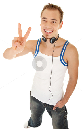 I am free to listen my music stock photo, Smiling handsome young man in casual style with headphones shows sign freedom, isolated on white background by Iryna Rasko