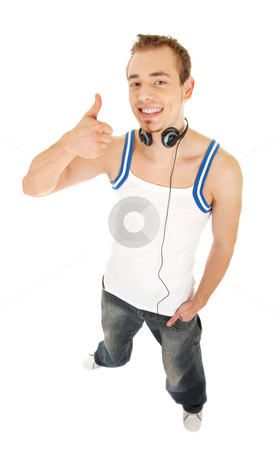 Let's listen good music stock photo, Smiling handsome young man in casual style with headphones shows sign good, isolated on white background by Iryna Rasko