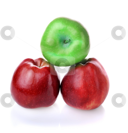 To be different green apple betwen red ones stock photo, Pyramid with one green apples and two red apples on white background by Iryna Rasko