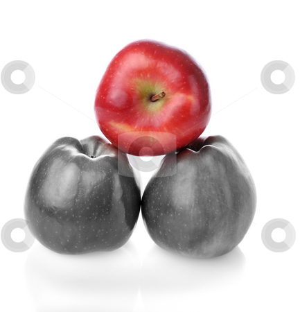 To be different bright one betwen colourless ones stock photo, Pyramid with one different red apples and two colourless apples on white background by Iryna Rasko