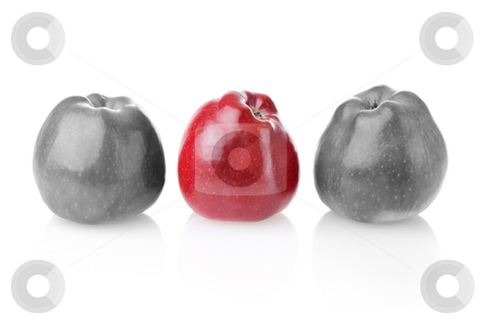 To be different bright one betwen colourless ones stock photo, Different bright red apple between two colourless apples on white background by Iryna Rasko