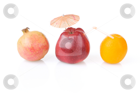 Time to drink fresh juice stock photo, Red apple with umbrella and tube, one pomegranate and orange by Iryna Rasko