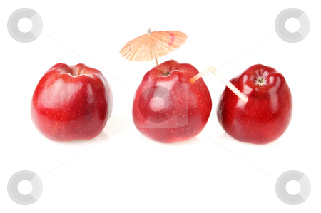 Tree red apples for fresh juice stock photo, Two fresh red apples and one apple with cocktail tube and umbrella by Iryna Rasko