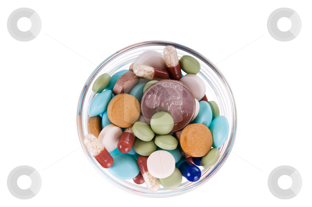 Fifty cents in saucer full of pills stock photo, Fifty cents in glass saucer full of different pills on white background by Iryna Rasko