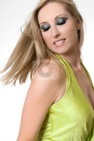 Female with blonde hair tossing or flicking her hair stock photo, Carefree female tossing blonde hair by Leah-Anne Thompson