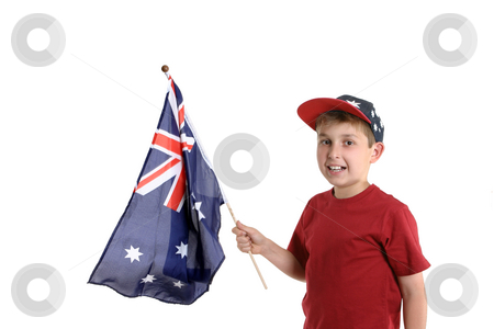 Child holding a flag stock photo, Young boy holding an Australian flag in his hand. by Leah-Anne Thompson