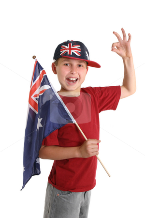 Proudly Australian stock photo, A young proud Aussie boy carrying a flag makes a gesture. by Leah-Anne Thompson